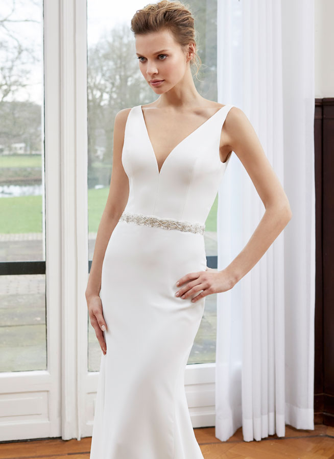 crepe fitted dress with v neckline round back and sparkle belt front