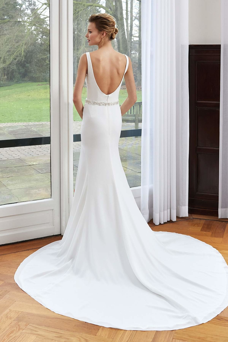 crepe fitted dress with v neckline round back with a sparkle belt back
